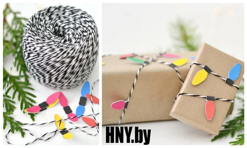 Упаковка новогодних товаров ниткой и цветной бумагой