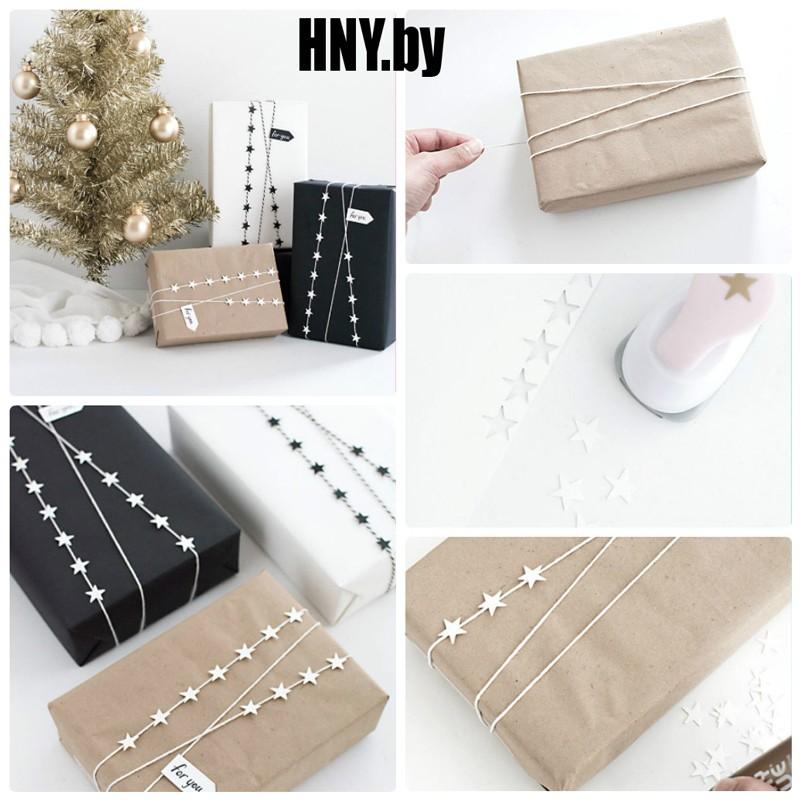 Украшение новогодней упаковки веревкой и бумажными звездами
