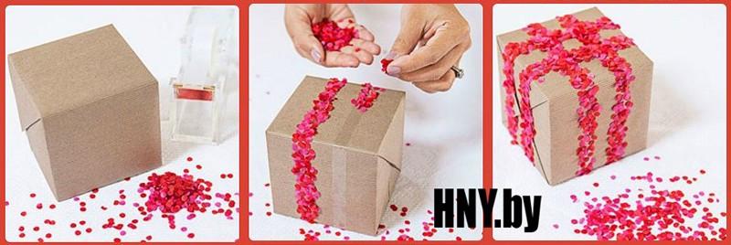 Декорируем новогоднюю упаковку бумажными кружочками из дырокола